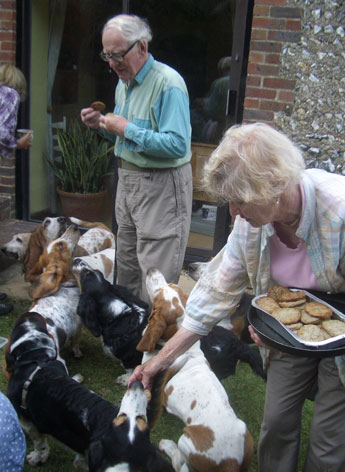 Jill and Brian giving BBQ treats to the Basset Hounds